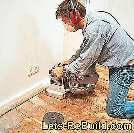 Renovating the board floor: Sand down and seal the wooden floorboards: sand