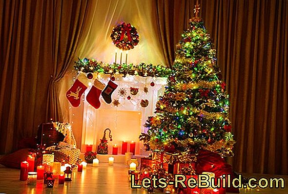 Decorating Christmas tree with candles - tree candles for the Christmas tree