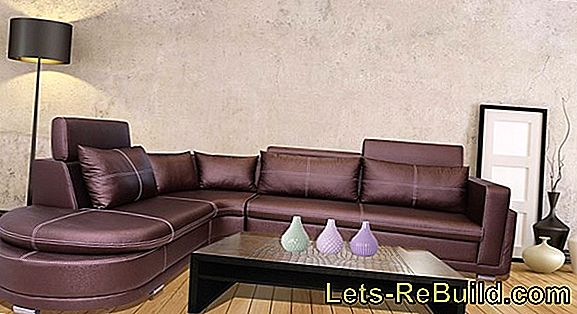 A white leatherette sofa gently clean the sofa