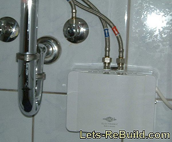 Install boiler: Hot water tank for kitchen and bathroom