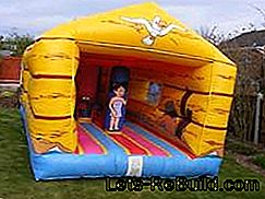 Trampoline And Bouncy Castle For Children In The Garden