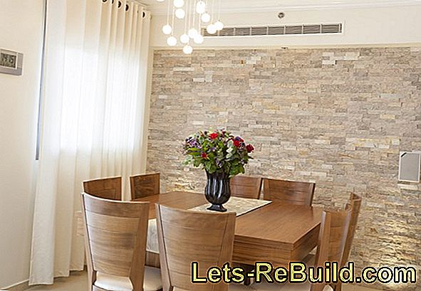 Stone wall in the dining room - design ideas