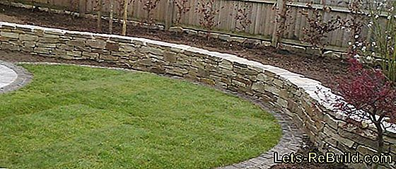 Make a natural stone wall in the garden itself