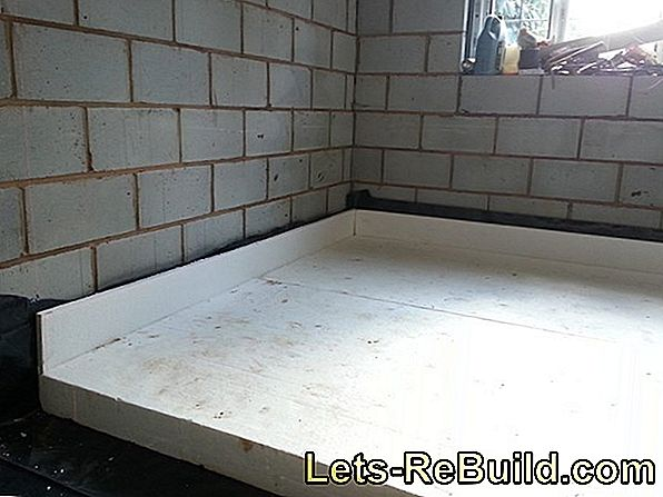 Lay polystyrene panels under screed as an insulating layer
