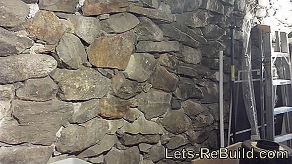 Seal the rubble stone wall - introduce drainage