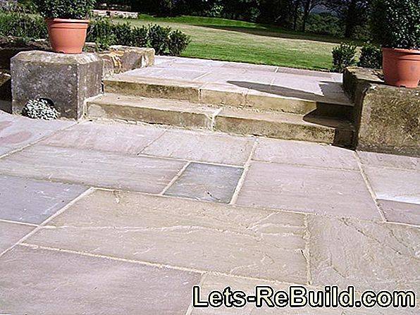 Lay patio slabs of natural stone or concrete