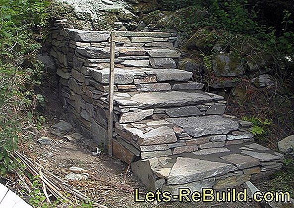 The planning of a natural stone staircase in the garden