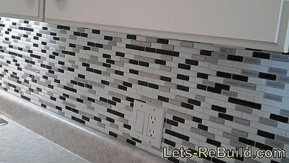 Stick wall tiles professionally
