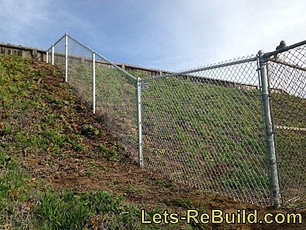 Chain link fence on the slope