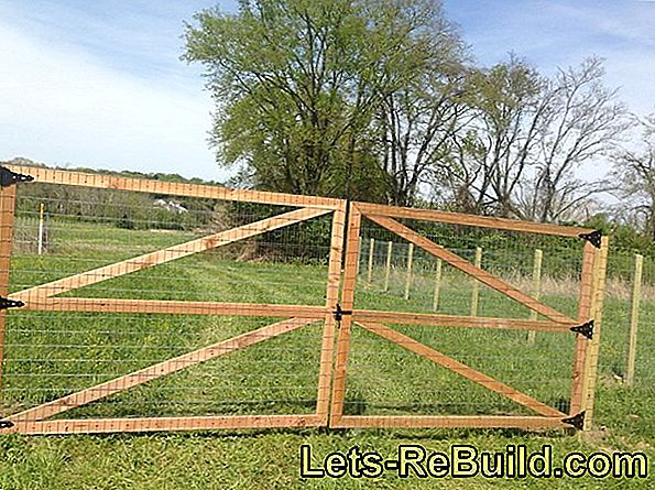 Build up wire mesh fence with wooden posts